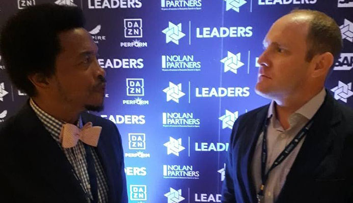 TTOC President Brian Lewis, left, chats with Whitney Kirkland, Partner, Firebrand Event Productions, at the 5th annual Leaders Sport Business Summit in New York last month.