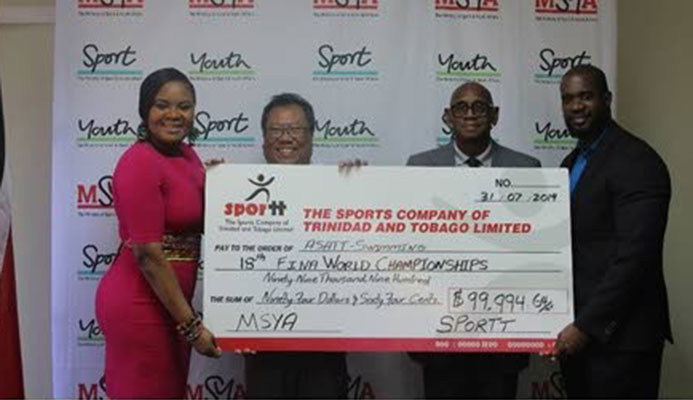 ASATT president Lindsay Gillette (second from left) collects a cheque from Sports Minister Shamfa Cudjoe (left), with Anthony Creed, executive manager at SPORTT (second from right) and Gabre Mc Tair, assistant director of Physical Education and Sport, looking on. PHOTO COURTESY MINISTRY OF SPORT AND YOUTH AFFAIRS